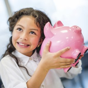 girl piggy bank stock image