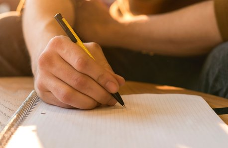 Man writes letter stock image