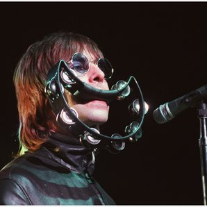Liam Gallagher performing with Oasis in 2000