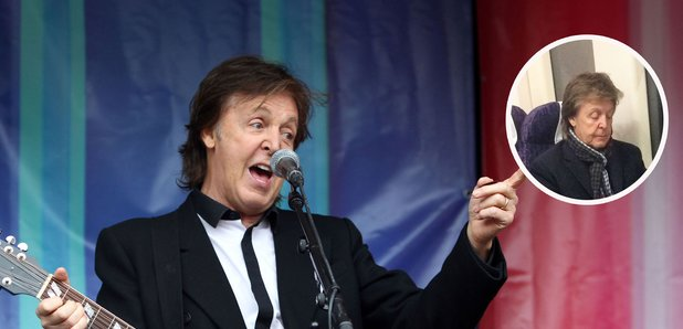 Paul McCartney performing and riding the train